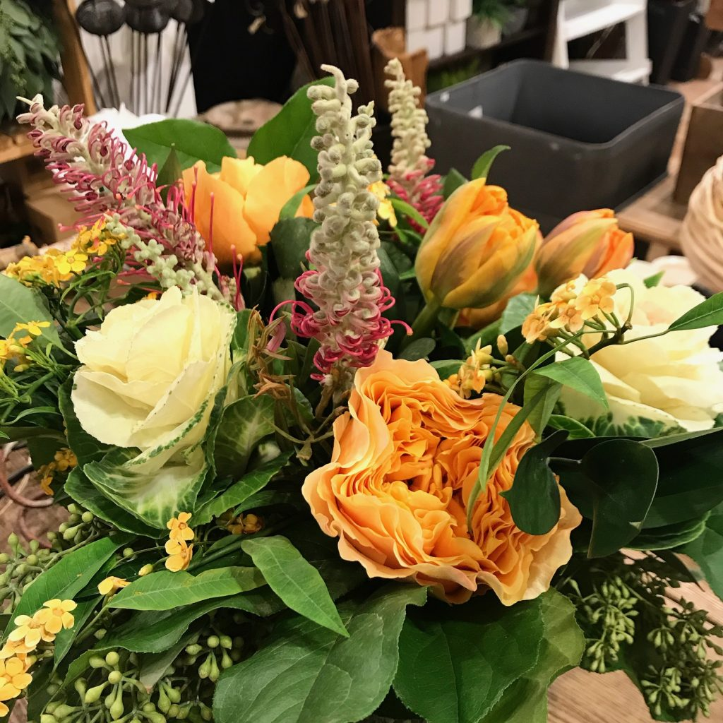 Pale yellow and orange flowers with pale yellow and greens flowers.