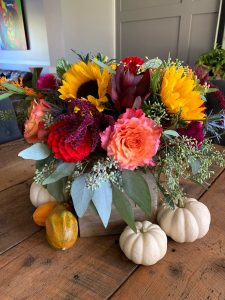 red dahlias, hot pink celosia, free spirit garden roses, yellow sunflowers and red Amaranthus