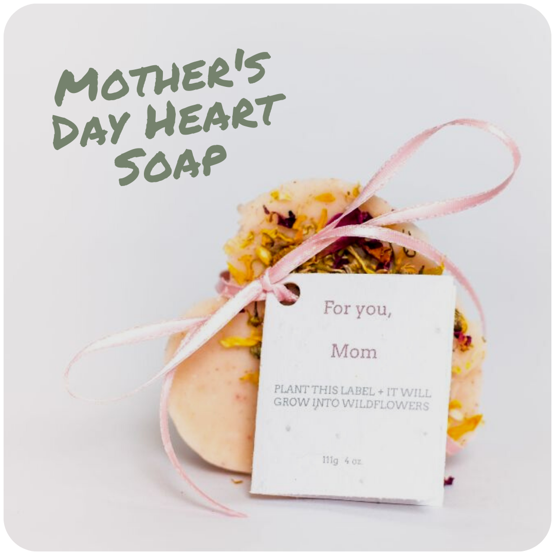 Image of a bar of soap shaped like a heart with plantable seed tag