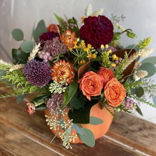 ORANGE CERAMIC PUMPKIN WITH BRIGHT SEASONAL FLOWERS